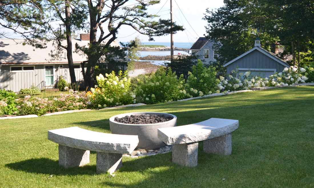 Back yard firepit with granite benches