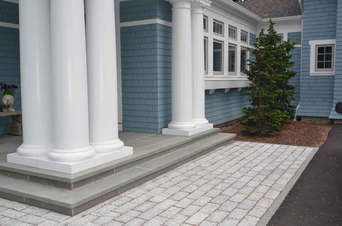 The cobblestone entryway lends an elegant touch