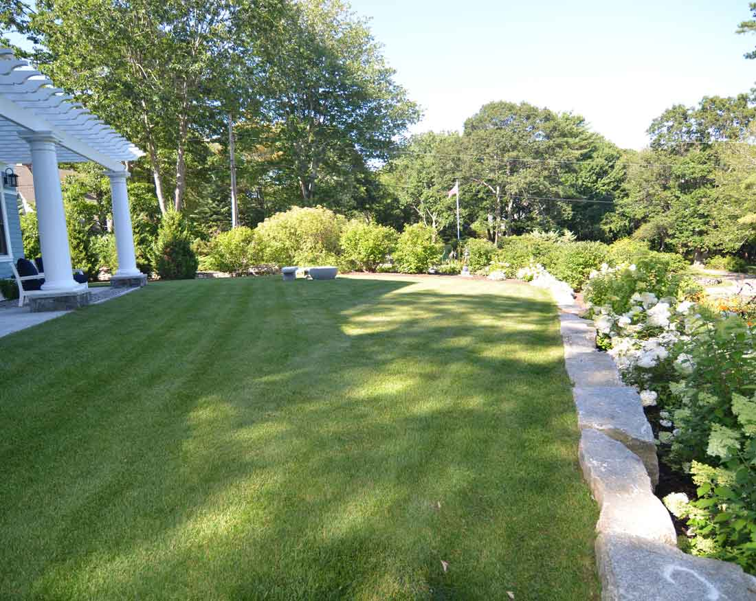 Granite rock wall supports grade change for septic system