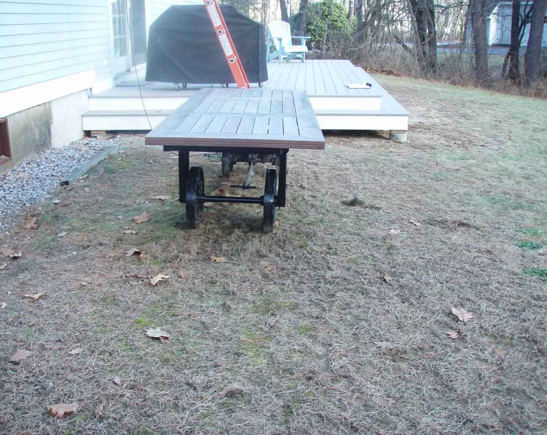 BEFORE construction - the patio area is a struggling lawn.