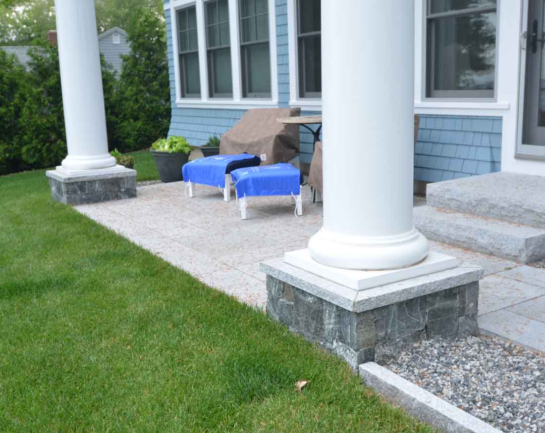 Granite patio with stone veneer at column bases