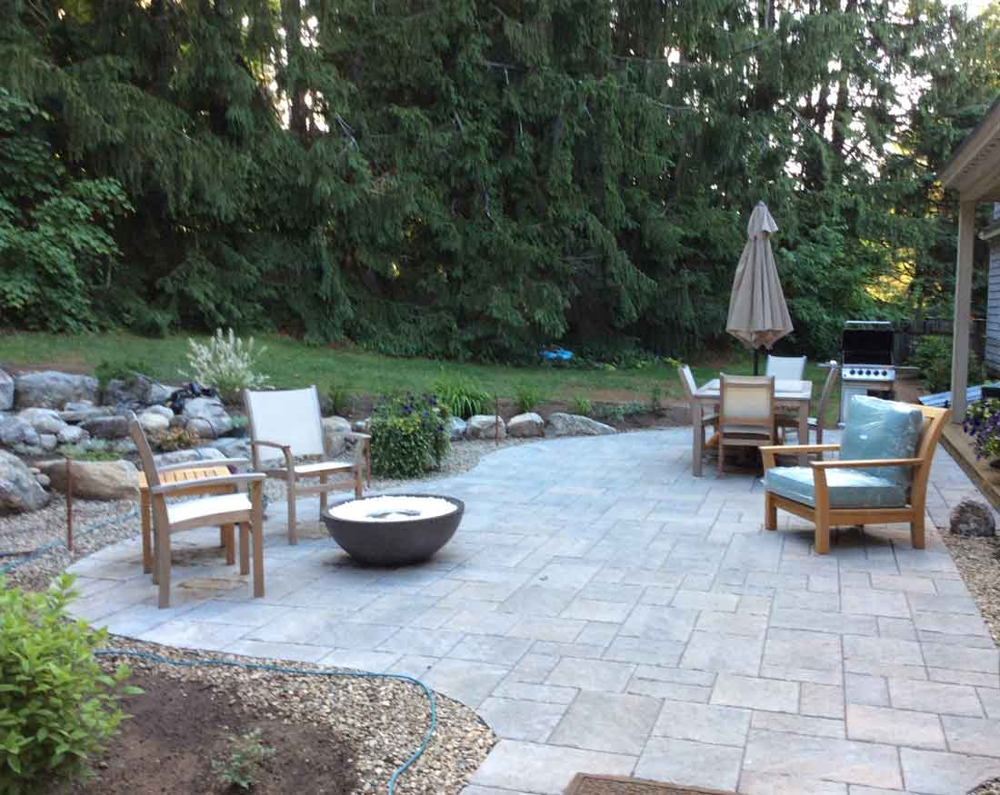 Patio with adjacent water feature
