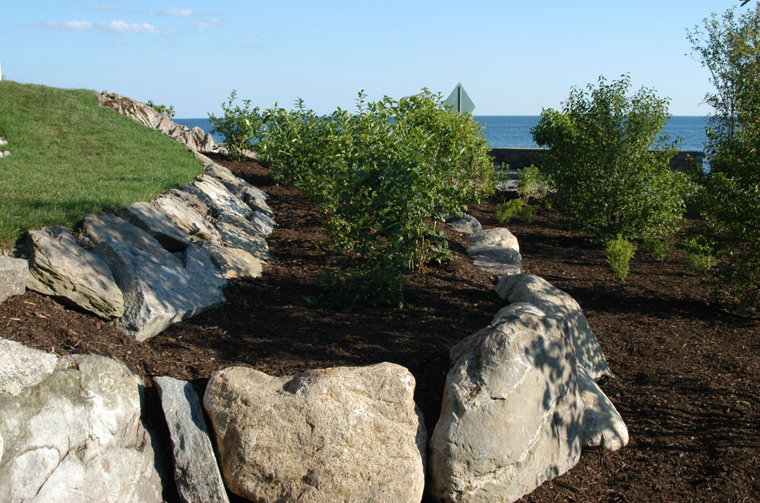 Boulders and granite slabs create planting beds