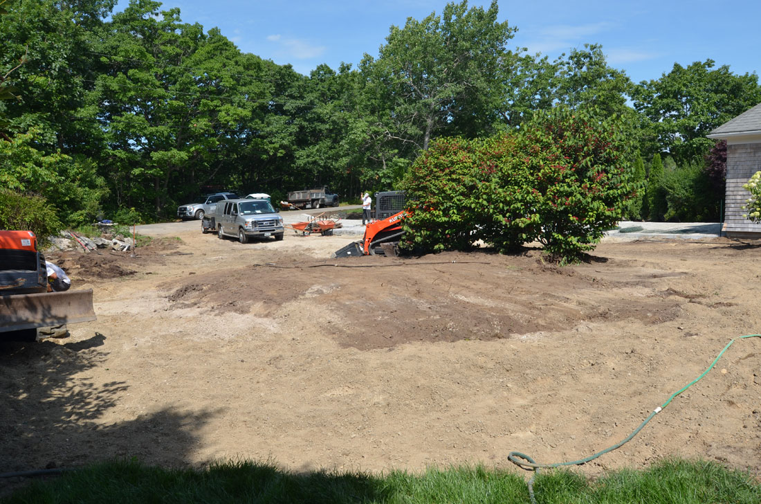 The circular driveway mound is graded