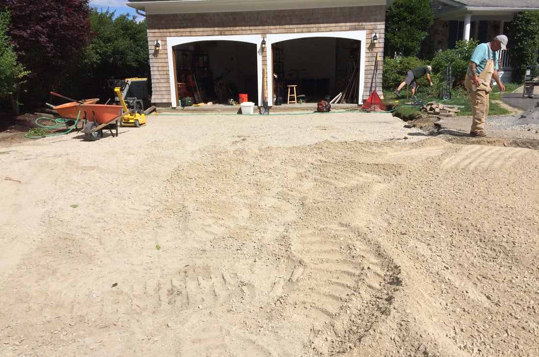 Compacted gravel is laid as driveway base