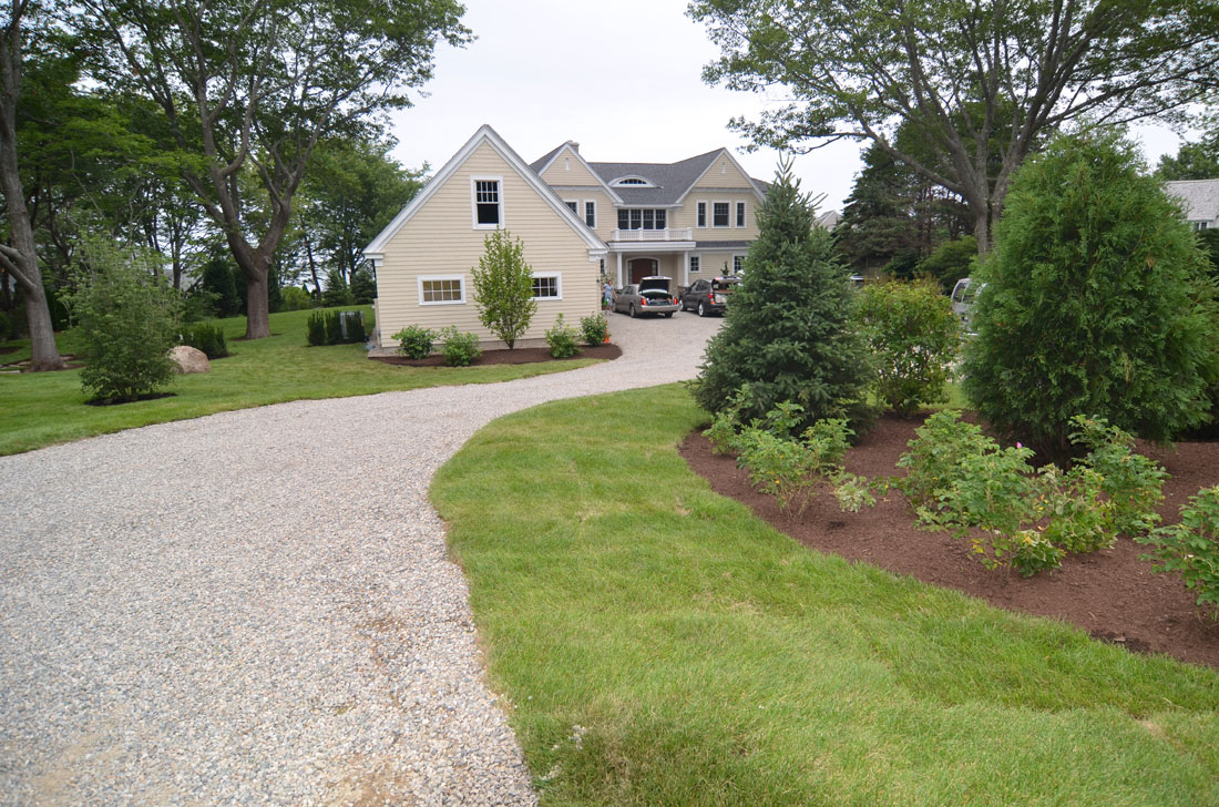The driveway is raised and curved