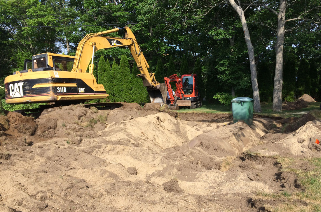 Excavating the propane tank for driveway