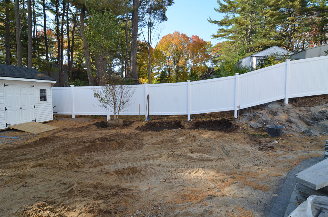A fence is installed around the patio